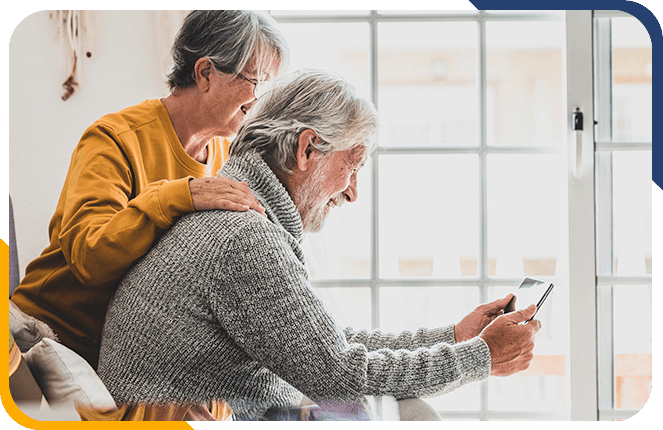 Retired couple looking at a tablet