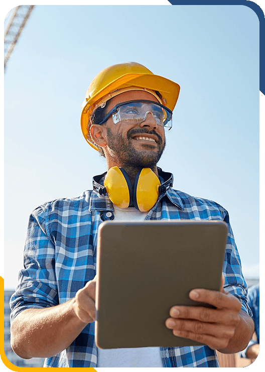 Construction worker handling administrative functions out in the field